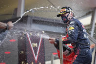 First place Red Bull driver Max Verstappen of the Netherlands, right, celebrates on the podium during the Monaco Grand Prix at the Monaco racetrack, in Monaco, Sunday, May 23, 2021. (Sebastien Nogier, Pool via AP)