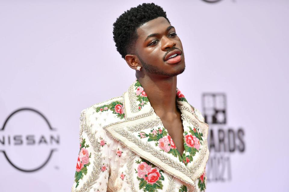Lil Nas X in a floral suit with a super-wide lapel