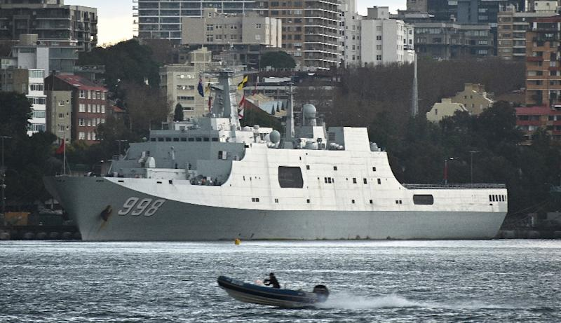 """The appearance of Chinese warships in Sydney Harbour forced Prime Minister Scott Morrison to reassure residents saying their arrival """"wasn't a surprise to the government"""" (AFP Photo/PETER PARKS)"""