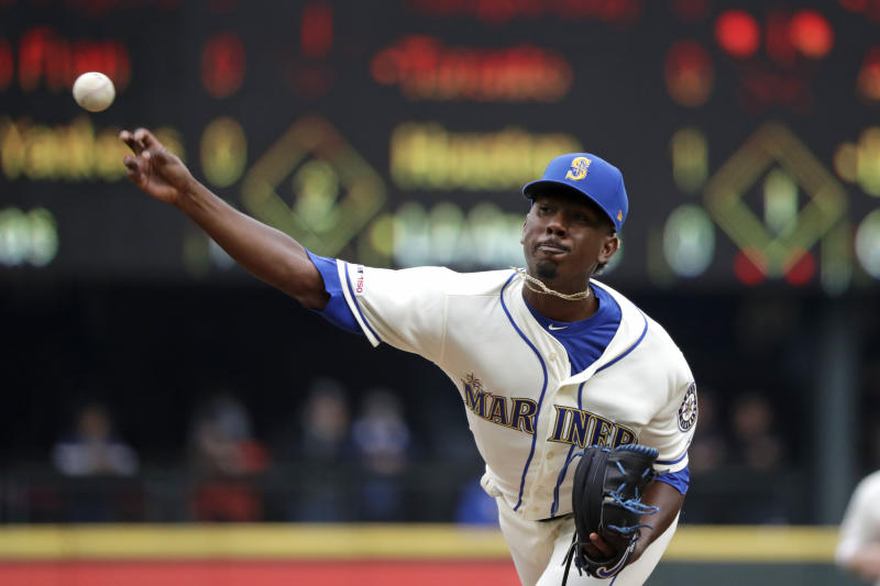 Seattle Mariners starting pitcher Justin Dunn throws against the Oakland Athletics in the second inning of a baseball game Sunday, Sept. 29, 2019, in Seattle. (AP Photo/Elaine Thompson)