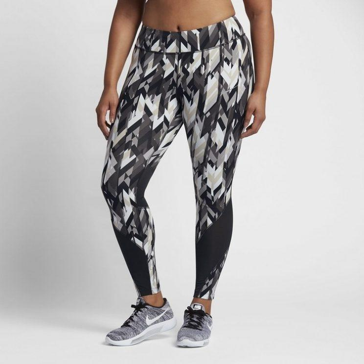 A model, from waist down, wears patterned athletic pants and Nike shoes.