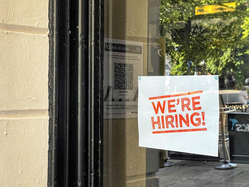 SIgn in the window of a pub advertsing for staff. Photo: Getty Images