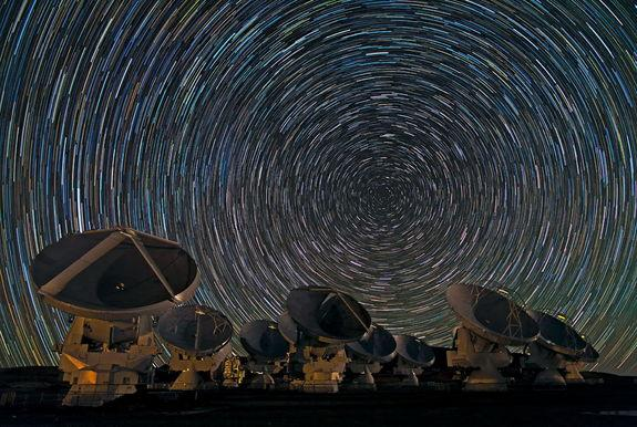 The antennas of the Atacama Large Millimeter/submillimeter Array (ALMA) shine under the southern sky. Image released Dec. 31, 2012.