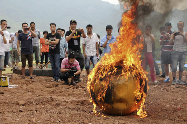 A smaller version of Noah's Ark of China, a six-ton (5,443 kg) ball container built by Chinese inventor Yang Zongfu, undergoes a burning test in Yiwu, Zhejiang province, August 6, 2012. According to local media, Yang spent two years and 1.5 million RMB (235,585 USD) to build the four-metre diameter vessel, which has been tested capable of housing a three-person family and sufficient food for them to live in 10 months. The vessel was designed to protect people inside from external heat, water and external impact. Picture taken August 6, 2012. REUTERS/China Daily (CHINA - Tags: SOCIETY SCIENCE TECHNOLOGY) CHINA OUT. NO COMMERCIAL OR EDITORIAL SALES IN CHINA