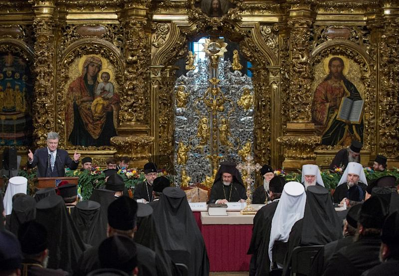 Ukrainian President Petro Poroshenko was present at the historic synod as it created a new Ukrainian Orthodox church independent from Russia (AFP Photo/Genya SAVILOV)