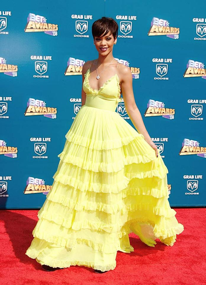 "Rihanna is ravishing, but the yucky yellow dress she sported to the star-studded event was ugly and unfortunate. Frazer Harrison/<a href=""http://www.gettyimages.com/"" target=""new"">GettyImages.com</a> - June 24, 2008"