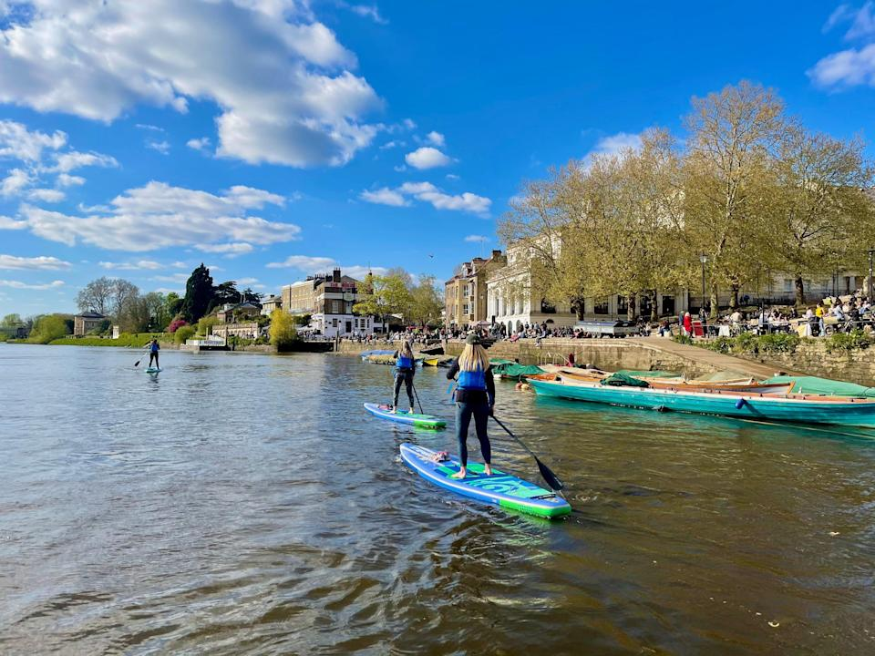 Katie Strick and her housemate Aislinn Santoni try paddleboarding in RichmondJames Brennan