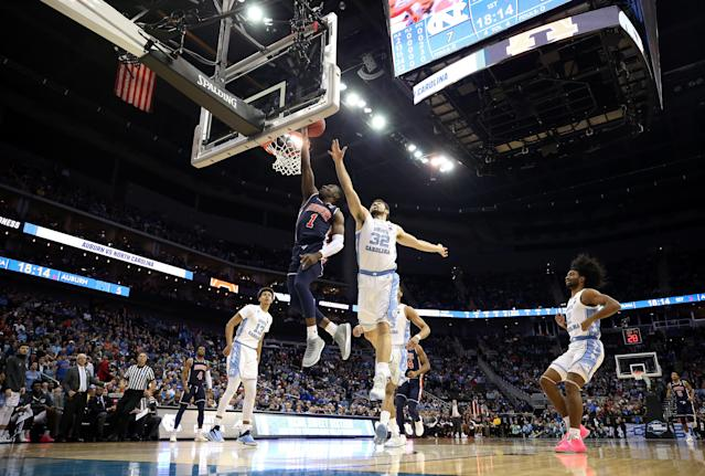 <p>Jared Harper #1 of the Auburn Tigers drives to the basket against Luke Maye #32 of the North Carolina Tar Heels during the 2019 NCAA Basketball Tournament Midwest Regional at Sprint Center on March 29, 2019 in Kansas City, Missouri. (Photo by Christian Petersen/Getty Images) </p>