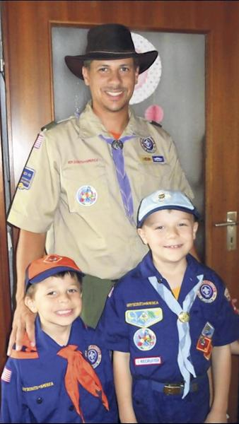 This undated family photo provided by Quernheim Funeral Home, shows David Decareaux, 36, and his sons, 8-year-old Grant and 10-year-old Dominic. The three died while hiking on Jan. 13, 2013. Only the family's 4-month-old yellow Labrador retriever survived the hike. He was found near Decareaux, who died at the scene, and the two boys, who were declared dead at a hospital after hours of efforts to revive them failed. (AP Photo/Family Photo Provided By Quernheim Funeral Home via Belleville News-Democrat) NO SALES