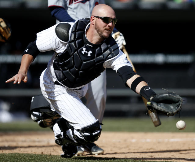 Chicago White Sox catcher Tyler Flowers comes up short on a bunt foul hit by Minnesota Twins' Kurt Suzuki during the seventh inning of a baseball game on Wednesday, April 2, 2014, in Chicago. (AP Photo/Andrew A. Nelles)