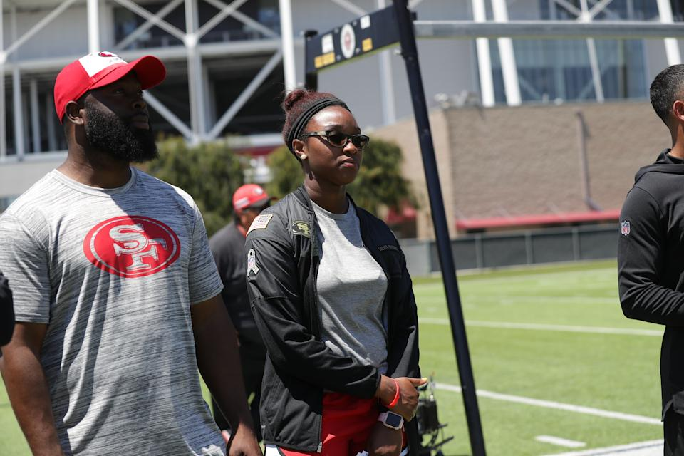 Salli Clavelle, standing with director of pro personnel Ran Carthon, has been with the 49ers since 2018. (Photo courtesy of the San Francisco 49ers)