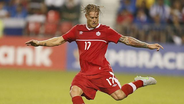 The 29-year-old joined fellow Canadian international David Edgar in signing with the Vancouver Whitecaps on Monday.