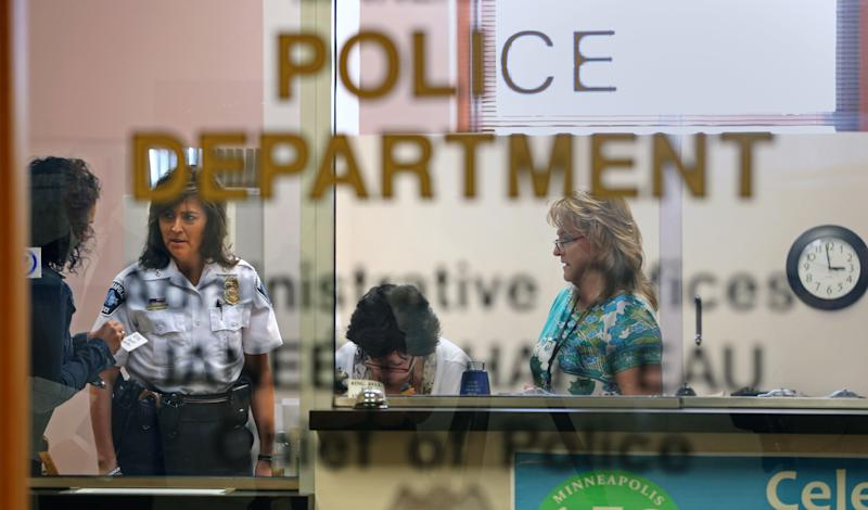 Then-Minneapolis Police Chief Janee Harteau talked to people attending a closed door meeting with community leaders on how to improve community relations with the police department on August 7, 2013. (Bruce Bisping/Star Tribune via Getty Images)