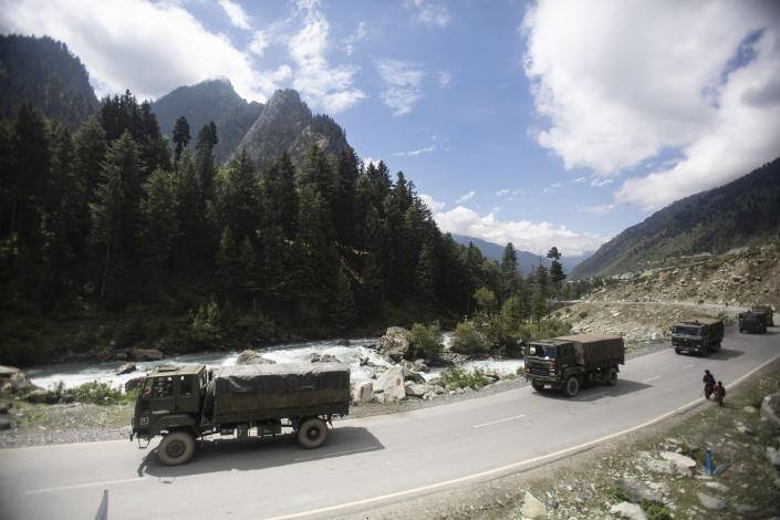 FILE - In this Sept. 1, 2020, file photo, an Indian army convoy moves on the Srinagar- Ladakh highway towards the cold-desert Ladakh region where China and India have been engaged in a tense standoff since May, at Gagangeer, northeast of Srinagar, Indian-controlled Kashmir. India has high hopes its ties with the United States will deepen under President Joe Biden, who was a key proponent of the 2008 civil nuclear deal between the countries and whose new administration includes several Indian Americans. Relations between the world's two largest democracies are driven in part by their desire to maintain strong ties as a counter to China (AP Photo/Mukhtar Khan, File)