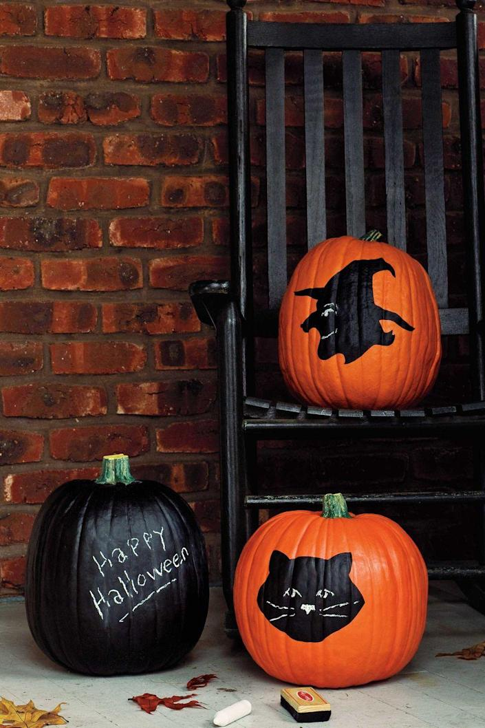 """<p>Create noteworthy designs on your pumpkin using chalkboard paint. Paint the whole pumpkin to make a message board, craft a silhouette, or let your kids add features to the characters using chalk.</p><p><a class=""""link rapid-noclick-resp"""" href=""""https://www.amazon.com/Chalkboard-American-Crafts-ounces-366867/dp/B00I99S3BC/?tag=syn-yahoo-20&ascsubtag=%5Bartid%7C10070.g.1902%5Bsrc%7Cyahoo-us"""" rel=""""nofollow noopener"""" target=""""_blank"""" data-ylk=""""slk:SHOP CHALKBOARD PAINT"""">SHOP CHALKBOARD PAINT</a> </p>"""