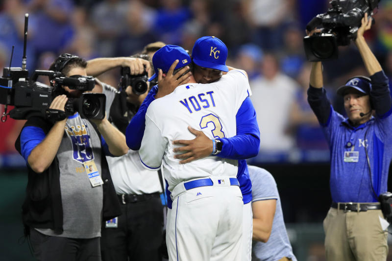 Kansas City Royals' Salvador Perez hugs manager Ned Yost (3) during a ceremony before a baseball game against the Minnesota Twins at Kauffman Stadium in Kansas City, Mo., Friday, Sept. 27, 2019. (AP Photo/Orlin Wagner)