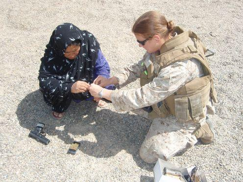"""<span class=""""caption"""">A Helmandi policewoman is trained to load and fire a weapon in 2009.</span> <span class=""""attribution""""><span class=""""source"""">Hannah West</span>, <span class=""""license"""">Author provided</span></span>"""