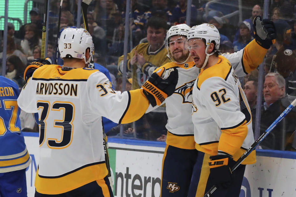 Nashville Predators' Filip Forsberg (9), of Sweden, and Ryan Johansen (92) celebrate Forsberg's goal during the first period of an NHL hockey game against the St. Louis Blues, Saturday, Nov. 23, 2019, in St. Louis. (AP Photo/Dilip Vishwanat)