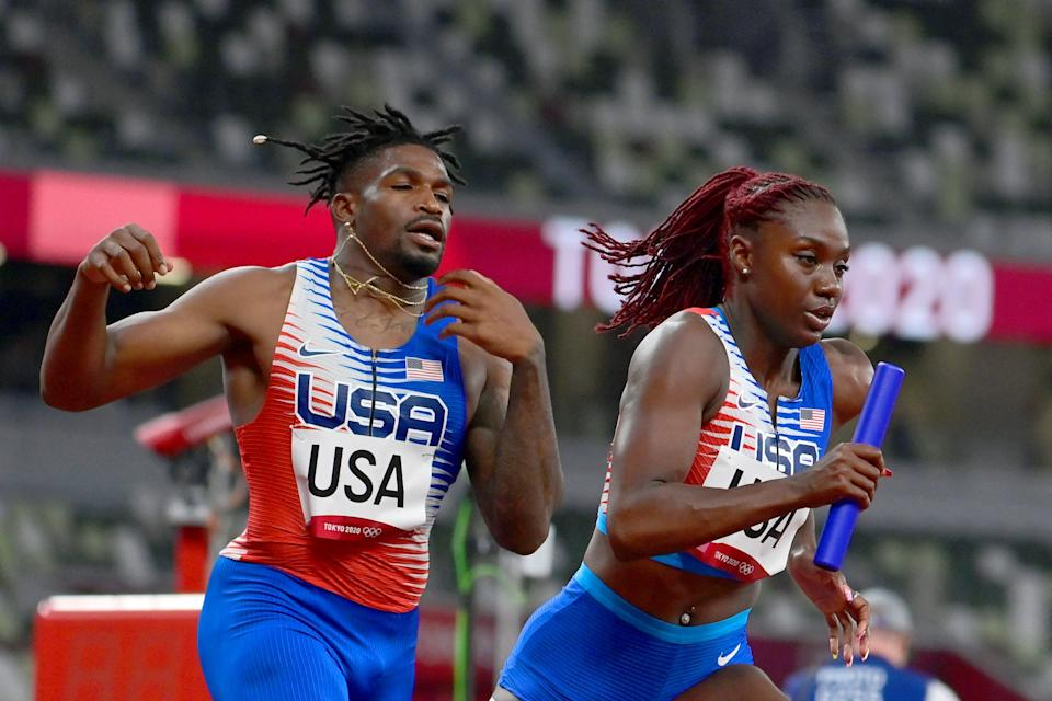 USA's Elija Godwin (L) and Lynna Irby compete in the mixed 4x400m relay heats during the Tokyo 2020 Olympic Games at the Olympic Stadium in Tokyo on July 30, 2021. (Photo by Javier SORIANO / AFP) (Photo by JAVIER SORIANO/AFP via Getty Images)