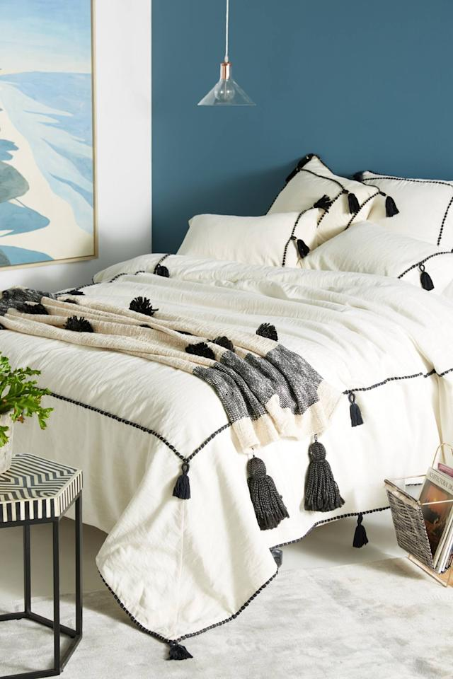 "<p>This cozy <a href=""https://www.popsugar.com/buy/Tasseled-Border-Duvet-547518?p_name=Tasseled%20Border%20Duvet&retailer=anthropologie.com&pid=547518&price=135&evar1=casa%3Aus&evar9=47189500&evar98=https%3A%2F%2Fwww.popsugar.com%2Fhome%2Fphoto-gallery%2F47189500%2Fimage%2F47190609%2FTasseled-Border-Duvet&list1=shopping%2Csales%2Chome%20decor%2Cfurniture%2Csale%20shopping%2Chome%20shopping&prop13=api&pdata=1"" rel=""nofollow"" data-shoppable-link=""1"" target=""_blank"" class=""ga-track"" data-ga-category=""Related"" data-ga-label=""https://www.anthropologie.com/shop/tasseled-border-duvet?category=sale-home&amp;color=018&amp;type=STANDARD"" data-ga-action=""In-Line Links"">Tasseled Border Duvet</a> ($135, originally $228) is so chic.</p>"