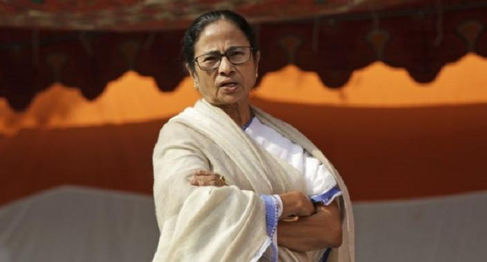 Mamata Banerjee, Chief Minister of West Bengal state talks as she staged a protest in public place in disagreement of recent raids by Central Bureau of Investigation (CBI)    in Kolkata, India, Monday, Feb. 4, 2019. Banerjee stayed overnight on street following the face off between Kolkata police and Central Bureau of Investigation officials on Sunday. (AP Photo/Bikas Das)