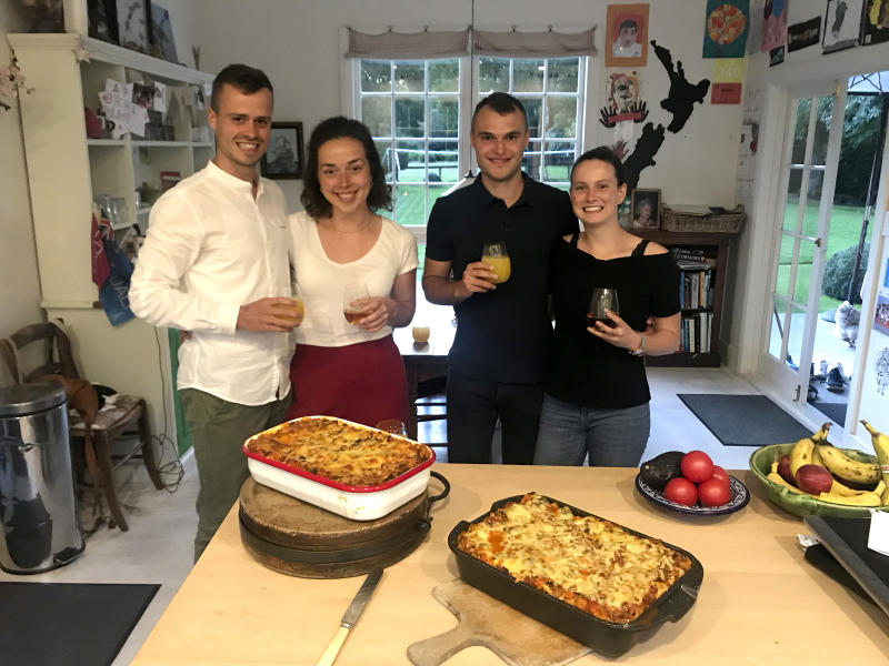 This April 3, 2020, photo provided by Felix Gard, shows German tourists from left, Felix Gard, Julia Betz, Thomas Metzler, Laura Spottke in Cambridge, New Zealand. Four German students who were invited by a New Zealand family to shelter with them during a nationwide lockdown say they've been having lots of fun sharing meals, playing football and trying to learn guitar. The students are among the 12,000 German visitors who have signed up for a repatriation program on flights chartered by the German government. (Felix Gard via AP)