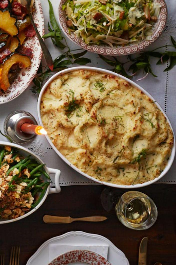 """<p>These luxurious fluffy, cheesy potatoes will make your potatoes seem like the star of the meal instead of a measly side dish. </p><p><strong><em><a href=""""https://www.womansday.com/food-recipes/food-drinks/recipes/a39911/buttermilk-boursin-potatoes-recipe-clx1114/"""" rel=""""nofollow noopener"""" target=""""_blank"""" data-ylk=""""slk:Get the Buttermilk-Boursin Mashed Potatoes recipe"""" class=""""link rapid-noclick-resp"""">Get the Buttermilk-Boursin Mashed Potatoes recipe</a>.</em></strong></p>"""