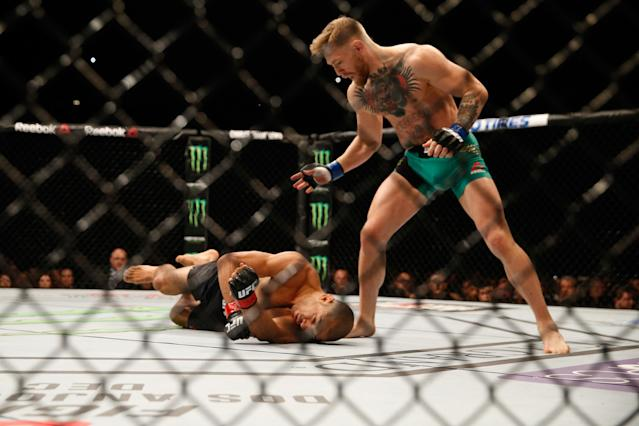 <p>McGregor then set his sights on longtime featherweight kingpin Jose Aldo, which turned into MMA's biggest storyline of 2015. The duo went on a multi-country press tour to hype their planned UFC 189 bout, but Aldo had to pull out just two weeks before the fight because of a rib injury. McGregor accepted a bout with replacement Chad Mendes for an interim championship, saving the show. McGregor answered critics of his wrestling game by withstanding the former NCAA wrestling standout's grappling game for two rounds before smoking Mendes with his big left and ending things with two seconds left in the second. McGregor and Aldo were rescheduled for UFC 194 in December, which came to a swift and stunning conclusion when McGregor dropped Aldo with a left and took the belt via knockout in just 13 seconds. Not only did McGregor take the featherweight belt, but the Mendes fight did 825,000 per-pay-view buys and the Aldo fight 1.2 million, establishing McGregor as a transcendent star. </p>