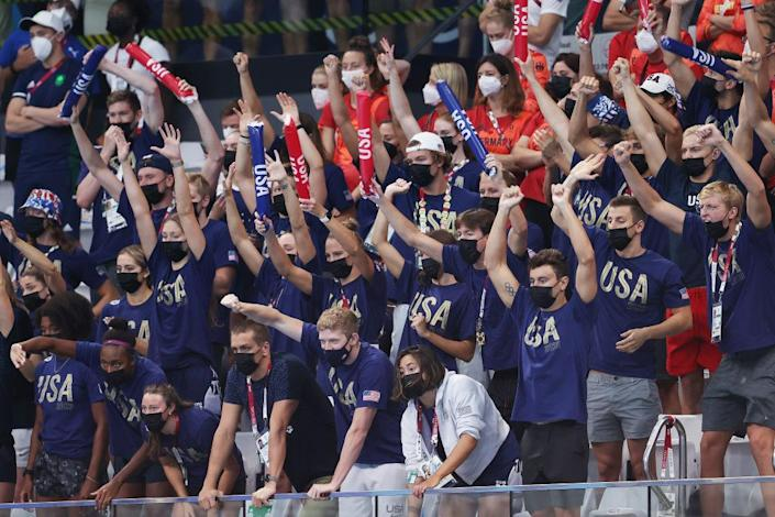 """Team USA cheers during day nine of the Tokyo 2020 Olympic Games at Tokyo Aquatics Centre on August 01, 2021 in Tokyo, Japan.<span class=""""copyright"""">Clive Rose—Getty Images</span>"""