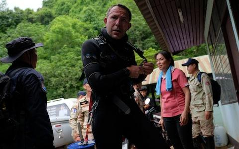 British cave-divers John Volanthen removes his diving suit after walking out from Tham Luang Nang Non cave on June 28 - Credit: Linh Pham /Getty