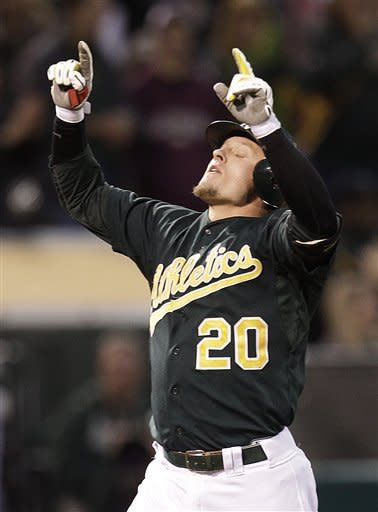 Oakland Athletics' Josh Donaldson celebrates after hitting a two-run home run off Boston Red Sox's Aaron Cook in the second inning of a baseball game Friday, Aug. 31, 2012, in Oakland, Calif. (AP Photo/Ben Margot)