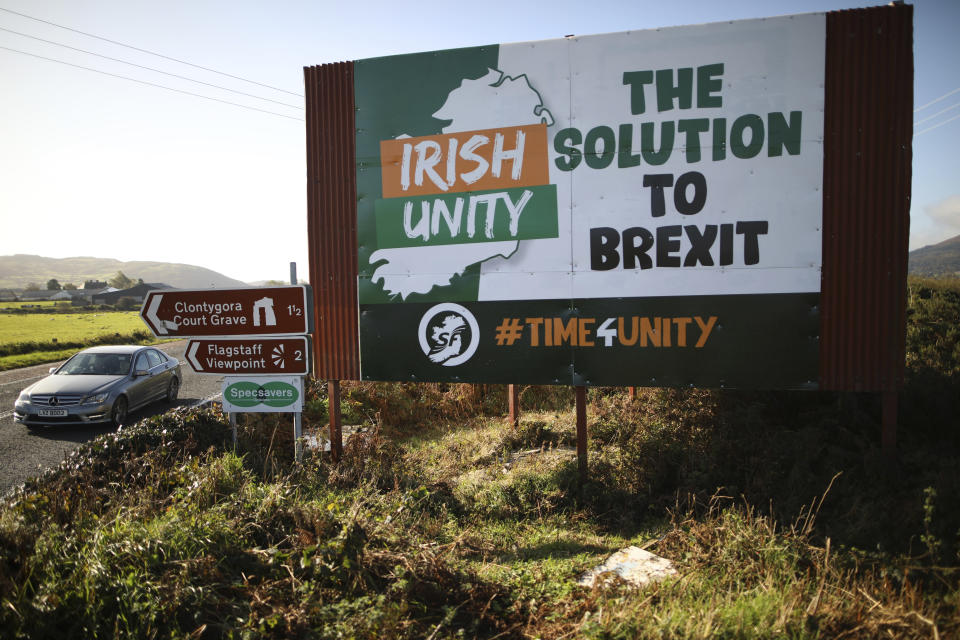 """FILE - In this Wednesday Oct. 16, 2019 file photo motorists pass along the old Belfast to Dublin road close to the Irish border in Newry, Northern Ireland. The chaotic scenes during a week of violence on the streets of Northern Ireland have stirred memories of decades of Catholic-Protestant conflict, known as """"The Troubles."""" A 1998 peace deal ended large-scale violence but did not resolve Northern Ireland's deep-rooted tensions. (Photo/Peter Morrison, File)"""