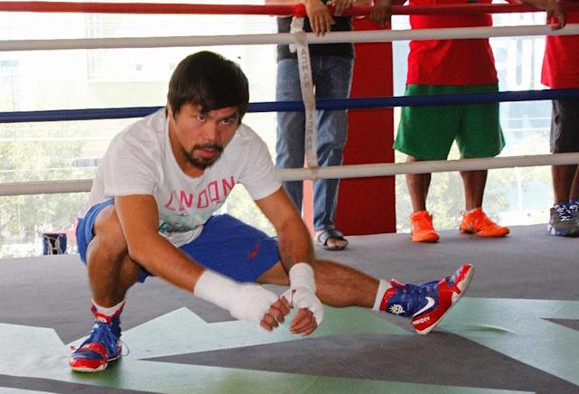 Philippine boxing icon Manny Pacquaio attends a training session at a gym in General Santos City on the southern island of Mindanao on February 21, 2015 (AFP Photo/STR)