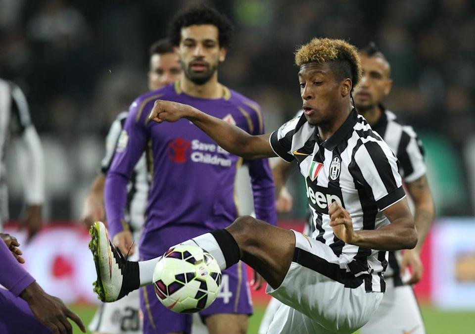 Kingsley Coman in action for Juventus in 2015, with Fiorentina's Mohamed Salah watching on.