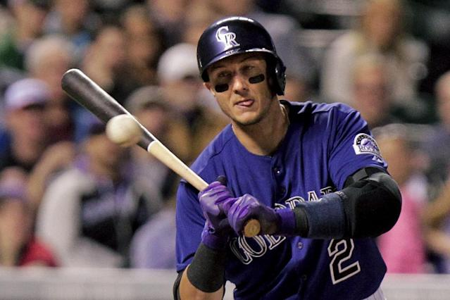 Colorado Rockies' Troy Tulowitzki (2) watches ball one go by during the sixth inning of a baseball game against the Chicago White Sox, Tuesday, April 8, 2014, in Denver. (AP Photo/Barry Gutierrez)