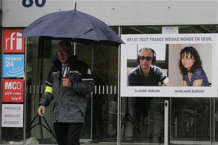 A poster with the portraits of reporter Ghislaine Dupont and radio technician Claude Verlon is seen at the entrance of Radio France Internationale building near Paris