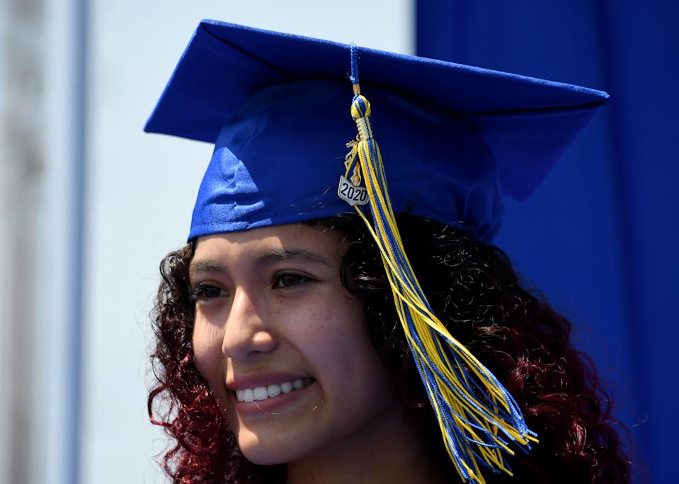 Graduate Suheit Rocha smiles as she has a portrait taken during a drive through graduation due to the coronavirus on Thursday, May 28, 2020. (Photo by Keith Birmingham/MediaNews Group/Pasadena Star-News via Getty Images)