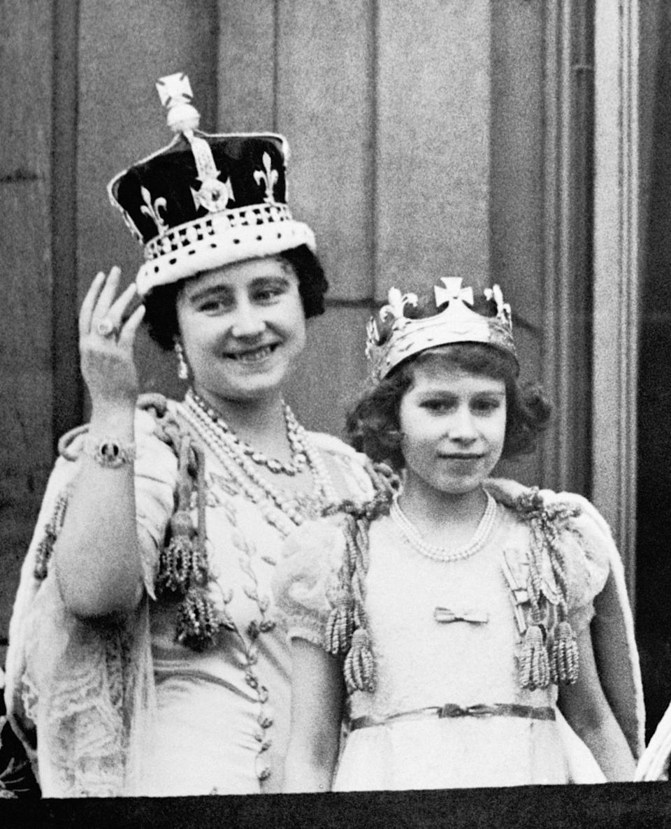 <p>Princess Elizabeth stands on the balcony of Buckingham Palace, after the coronation of King George VI (PA Archive) </p>