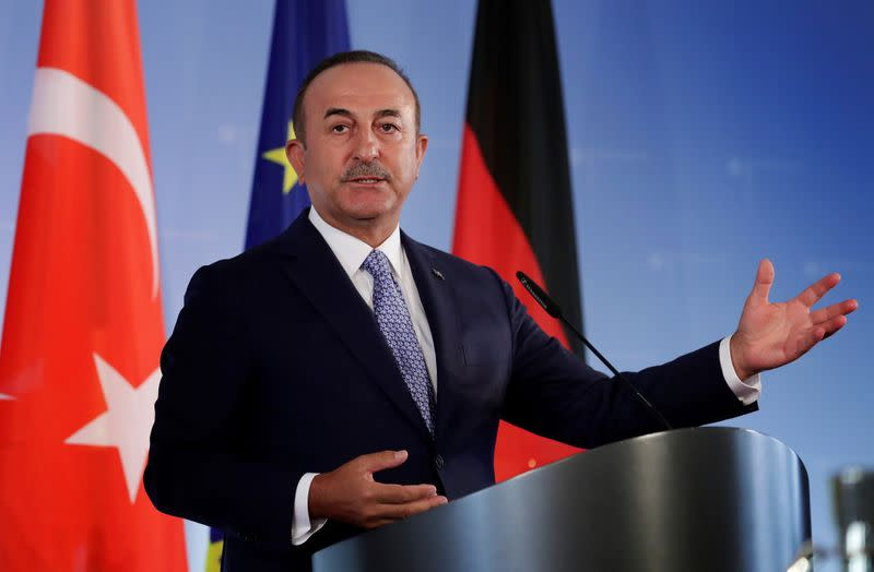 FILE PHOTO: German Foreign Minister Heiko Maas and Turkish Foreign Minister Mevlut Cavusoglu address the media during a joint news conference after a meeting in Berlin