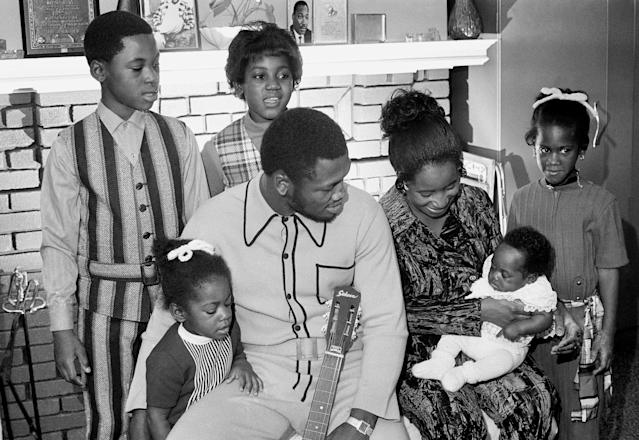 FILE - In this file photo taken Nov. 22, 1970, heavyweight champion Joe Frazier and his family pose for a family portrait after he returns from a successful defense of his boxing title in Philadelphia. While his wife Florence tries to make their youngest, Natasha, 12 weeks, Joe holds Jo-Netta. Standing behind them, from left, are Jaquelyn, 9, Marvis, 10, and Weatha, 7. The former champion died after a brief fight with liver cancer. He was 67. The family issued a release confirming the boxer's death on Monday, Nov. 7, 2011. (AP Photo, File)