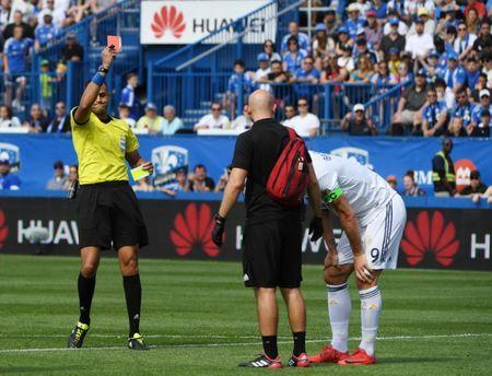 May 21, 2018; Montreal, Quebec, CAN; Los Angeles Galaxy forward Zlatan Ibrahimovic (9) gets a red card from referee Ismail Elfath during the first half of the game against the Montreal Impact at Stade Saputo. Mandatory Credit: Eric Bolte-USA TODAY Sports