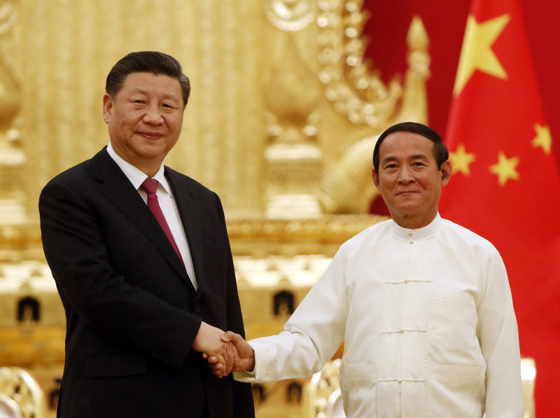 FILE - In this Jan. 17, 2020, file photo, Myanmar's President Win Myint, right, shakes hands with Chinese President Xi Jinping during their meeting at the Presidential Palace in Naypyitaw, Myanmar. Xi deepened relations with Myanmar during a state visit last week to a neighbor who has been among the most supportive in Beijing's dispute with other members of the Association of Southeast Asian Nations over the South China Sea.  (AP Photo/Aung Shine Oo, File)