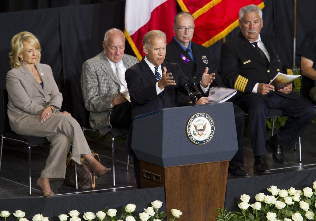 Vice President Joe Biden speaks during a memorial service for the 19 fallen firefighters at Tim's Toyota Center in Prescott Valley, Ariz. on Tuesday, July 9, 2013. Prescott's Granite Mountain Hotshots were overrun by smoke and fire while battling a blaze on a ridge in Yarnell, about 80 miles northwest of Phoenix on June 30, 2013. (AP Photo/The Arizona Republic, Michael Chow, Pool)