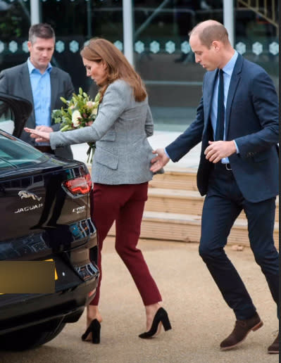 Kate Middleton's shoe falls off her foot in a wardrobe fail while Prince Williams comes to her aid while the pair leave the Shout's Crisis Volunteer celebration event at Troubadour White City Theatre on November 12, 2019