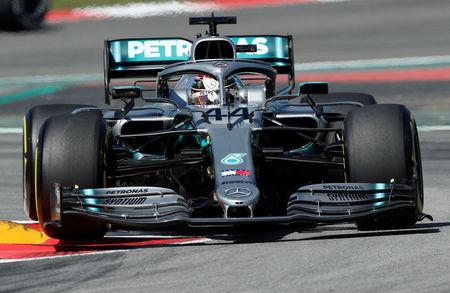 Hamilton wins in Spain to take F1 championship lead