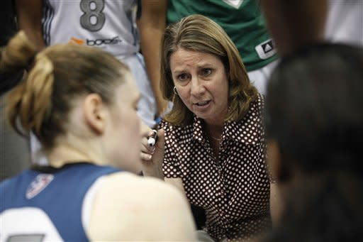 Minnesota Lynx coach Cheryl Reeve talks with her team during a timeout against the Los Angeles Sparks in the second half of a WNBA basketball game, Thursday, May 24, 2012, in Minneapolis. The Lynx won 92-84. (AP Photo/Stacy Bengs)
