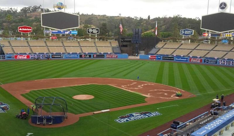 Crews prepare Dodger Stadium before the opening-day game on April 6.