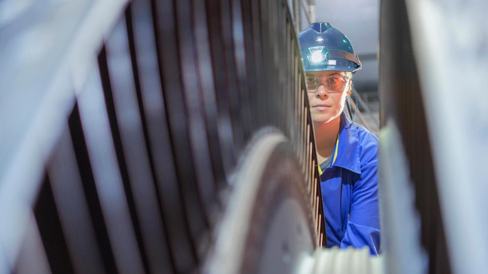 A woman works at a nuclear power plant.