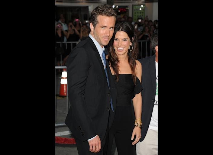 LOS ANGELES, CA - AUGUST 01: Actors Ryan Reynolds (L) and Sandra Bullock arrive at the premiere of Universal Pictures' 'The Change-Up' held at the Regency Village Theatre on August 1, 2011 in Los Angeles, California. (Photo by Jason Merritt/Getty Images)