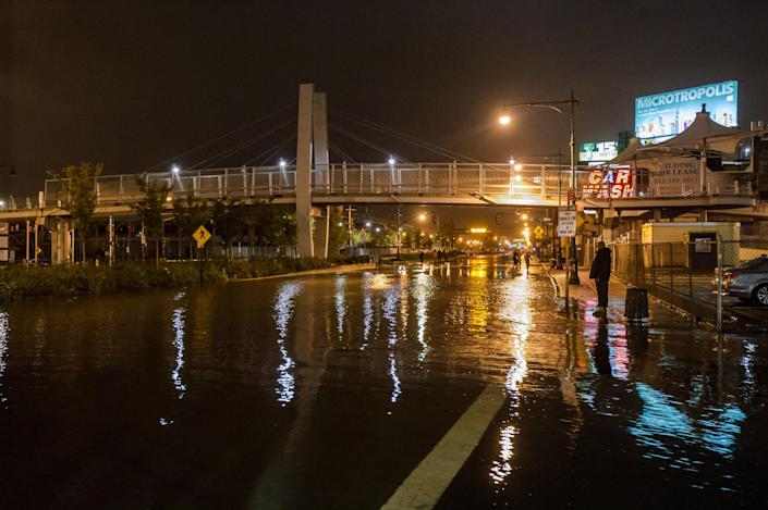 This photo provided by Dylan Patrick shows flooding along the Westside Highway near the USS Intrepid as Sandy moves through the area Monday, Oct. 29, 2012 in New York. Much of New York was plunged into darkness Monday by a superstorm that overflowed the city's historic waterfront, flooded the financial district and subway tunnels and cut power to nearly a million people. (AP Photo/Dylan Patrick) MANDATORY CREDIT: DYLAN PATRICK